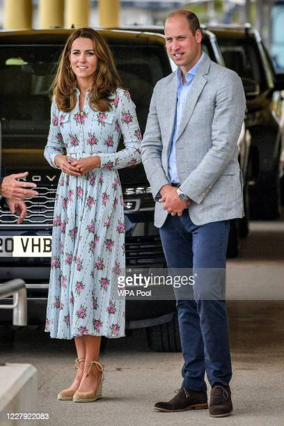 Prince William Duke of Cambridge and Catherine Duchess of Cambridgearrive by car to visit beach huts during their visit to Barry Island South Wales...