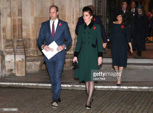 Prince William Duke of Cambridge and Catherine Duchess of Cambridge followed by Prince Harry Duke of Sussex and Meghan Duchess of Sussex leave after...