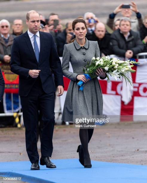 Prince William Duke of Cambridge and Catherine Duchess of Cambridge pay tribute to those who were tragically killed in the helicopter crash on...