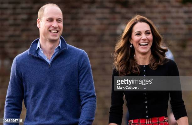 Prince William Duke of Cambridge and Catherine Duchess of Cambridge attend a Christmas Party for families and children of deployed personnel from RAF...