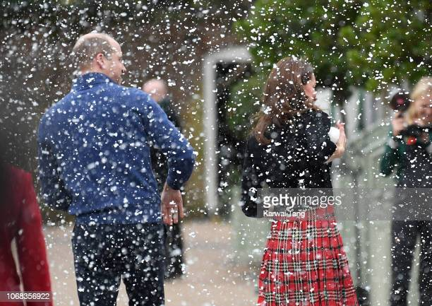 Prince William Duke of Cambridge and Catherine Duchess of Cambridge has a snowball fight with staff after hosting a Christmas party for families of...
