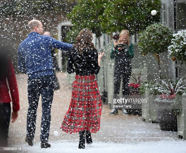 Prince William Duke of Cambridge and Catherine Duchess of Cambridge have a snowball fight with staff after hosting a Christmas party for families of...