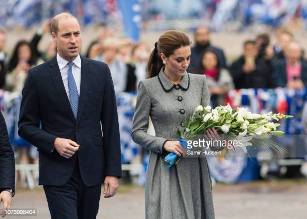 Prince William Duke of Cambridge and Catherine Duchess of Cambridge arrive at Leicester City Football Club to pay tribute to those who were...