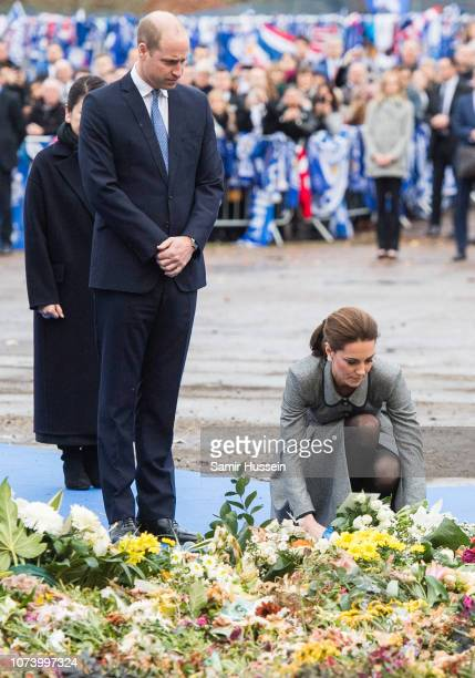 Prince William Duke of Cambridge and Catherine Duchess of Cambridge lay a wreath at Leicester City Football Club to pay tribute to those who were...