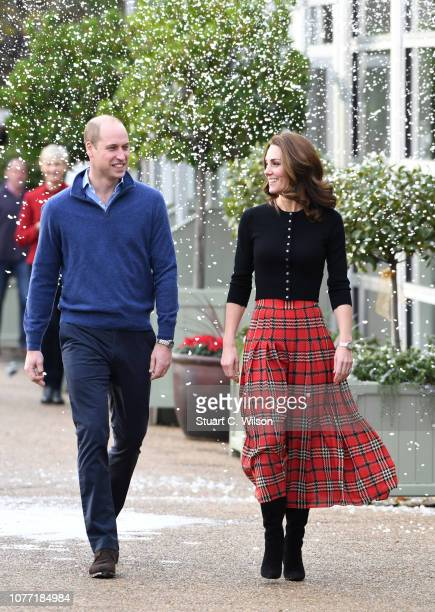Prince William Duke of Cambridge and Catherine Duchess of Cambridge laugh as a machine sprays snow ahead of their royal highnesses hosting a...