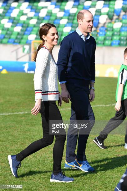 Prince William Duke of Cambridge and Catherine Duchess of Cambridge take part in a football training session with children during a visit the...