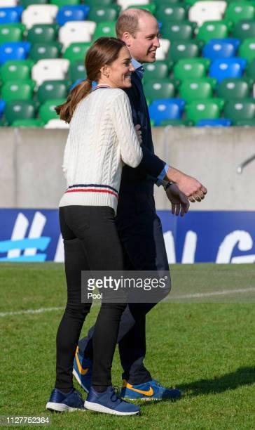 Prince William, Duke of Cambridge and Catherine, Duchess of Cambridge take part in a football training session with children during a visit the...