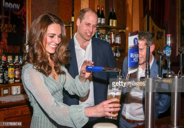 Prince William Duke of Cambridge and Catherine Duchess of Cambridge pull pints of lager as they visit the Empire Music Hall on February 27 2019 in...