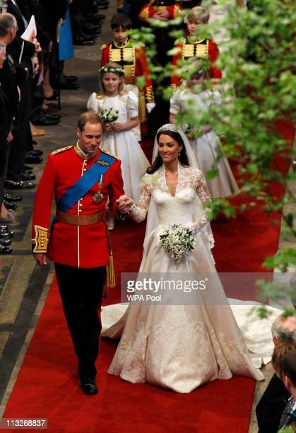 Prince William, Duke of Cambridge and Catherine, Duchess of Cambridge smile following their marriage at Westminster Abbey on April 29, 2011 in...