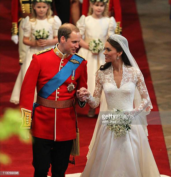 Prince William, Duke of Cambridge and Catherine, Duchess of Cambridge leave Westminster Abbey following their marriage ceremony, on April 29, 2011 in...