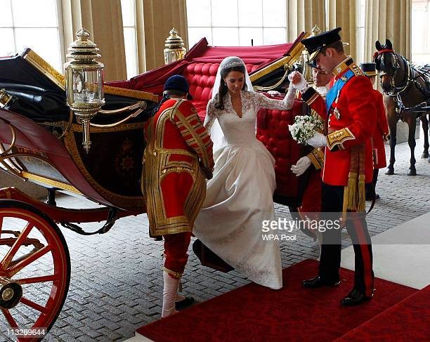 Prince William Duke of Cambridge and Catherine Duchess of Cambridge arrive at Buckingham Palace after their wedding at Westminster Abbey on April 29...