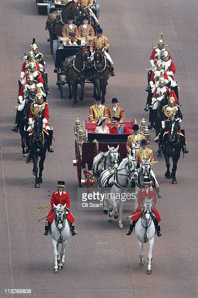 Prince William Duke of Cambridge and Catherine Duchess of Cambridge approach by carriage procession Buckingham Palace following their marriage at...