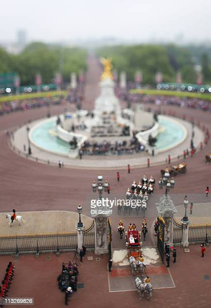 TRH Prince William Duke of Cambridge and Catherine Duchess of Cambridge approach by carriage procession Buckingham Palace following their marriage at...