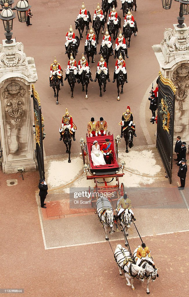Prince William, Duke of Cambridge and Catherine, Duchess of Cambridge approach by carriage procession, Buckingham Palace following their marriage at Westminster Abbey on April 29, 2011 in London, England. The marriage of the second in line to the British throne was led by the Archbishop of Canterbury and was attended by 1900 guests, including foreign Royal family members and heads of state. Thousands of well-wishers from around the world have also flocked to London to witness the spectacle and pageantry of the Royal Wedding.