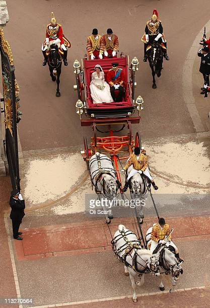 Prince William Duke of Cambridge and Catherine Duchess of Cambridge enter Buckingham Palace by carriage procession following their marriage at...