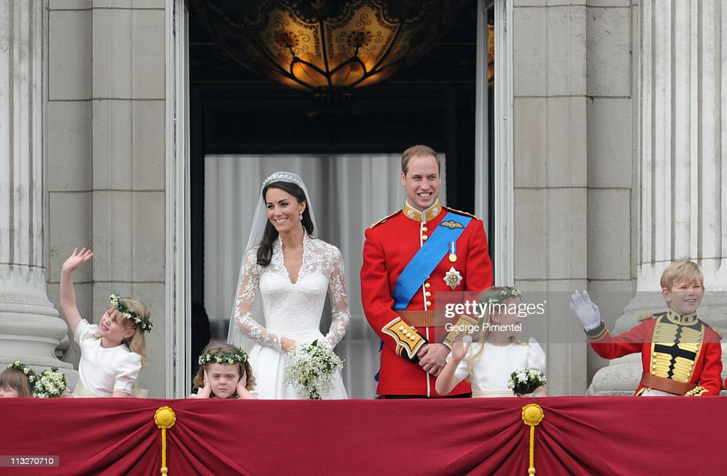 Prince William, Duke of Cambridge and Catherine, Duchess of Cambridge greet well-wishers from the balcony next to (L-R) Eliza Lopes, Lady Louise Windsor, Grace Van Cutsem, Margarita Armstrong-Jones and Tom Pettifer at Buckingham Palace on April 29, 2011 in London, England.