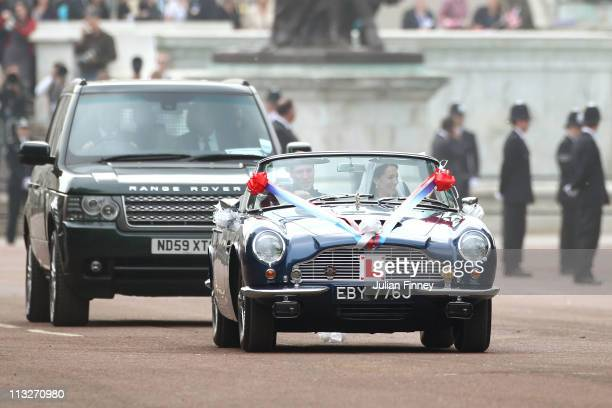 Prince William Duke of Cambridge and Catherine Duchess of Cambridge leave Buckingham Palace driving a convertible Aston Martin car on April 29 2011...