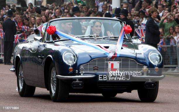 Prince William Duke of Cambridge and Catherine Duchess of Cambridge drive from Buckingham Palace in a vintage Aston Martin on April 29 2011 in London...