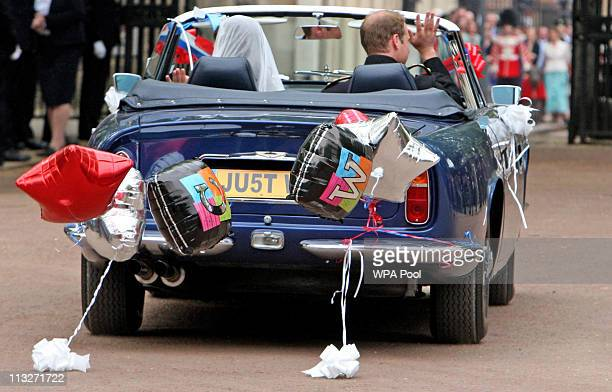 Prince William Duke of Cambridge and Catherine Duchess of Cambridge drive from Buckingham Palace to Clarence House in a vintage Aston Martin on April...