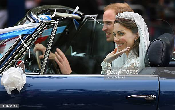 Prince William Duke of Cambridge and Catherine Duchess of Cambridge drive from Buckingham Palace in a decorated vintage Aston Martin sports car on...