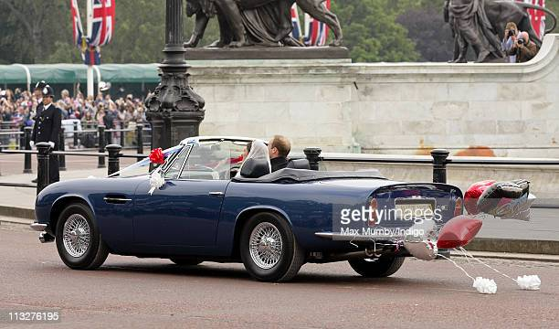 Prince William Duke of Cambridge and Catherine Duchess of Cambridge leave Buckingham Palace after their Wedding reception in Prince Charles' vintage...