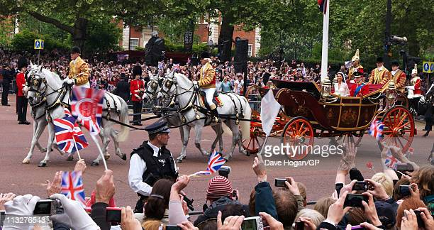 Prince William Duke of Cambridge and Catherine Duchess of Cambridge travel back to Buckingham Palace after the Royal Wedding of Prince William to...