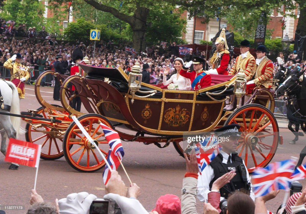 Prince William, Duke of Cambridge and Catherine, Duchess of Cambridge travel back to Buckingham Palace after the Royal Wedding of Prince William to Catherine Middleton on April 29, 2011 in London, England. The marriage of the second in line to the British throne was led by the Archbishop of Canterbury and was attended by 1900 guests, including foreign Royal family members and heads of state. Thousands of well-wishers from around the world have also flocked to London to witness the spectacle and pageantry of the Royal Wedding.