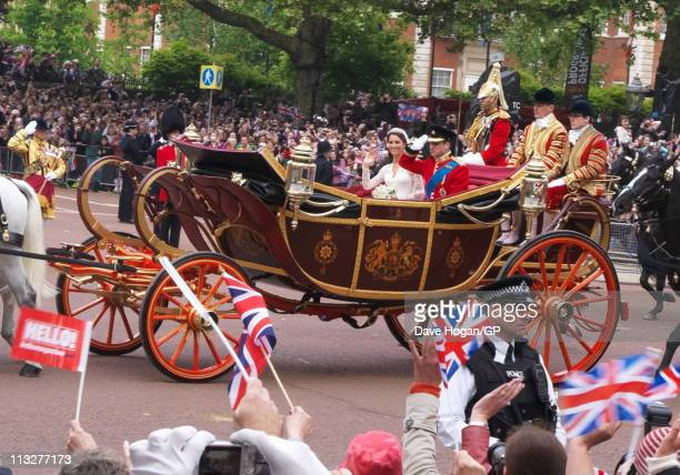 Prince William, Duke of Cambridge and Catherine, Duchess of Cambridge travel back to Buckingham Palace after the Royal Wedding of Prince William to...