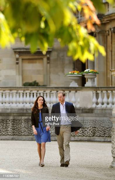 Prince William, Duke of Cambridge and Catherine, Duchess of Cambridge walk hand in hand from Buckingham Palace the day after their wedding to a...