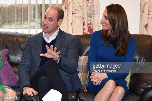 Prince William, Duke of Cambridge and Catherine, Duchess of Cambridge, meets service users during a visit St Joseph's SureStart Facility on February...