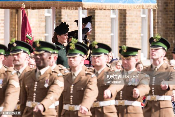 Prince William Duke of Cambridge and Catherine Duchess of Cambridge attend the 1st Battalion Irish Guards St Patrick's Day Parade at Cavalry Barracks...