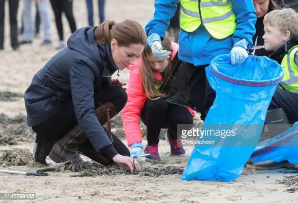 Prince William, Duke of Cambridge and Catherine, Duchess of Cambridge on a visit to Newborough Beach where they met the Menai Bridge Scouts and...