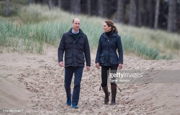 Prince William, Duke of Cambridge and Catherine, Duchess of Cambridge visit Newborough Beach to join the Menai Bridge Scouts as they explore the...