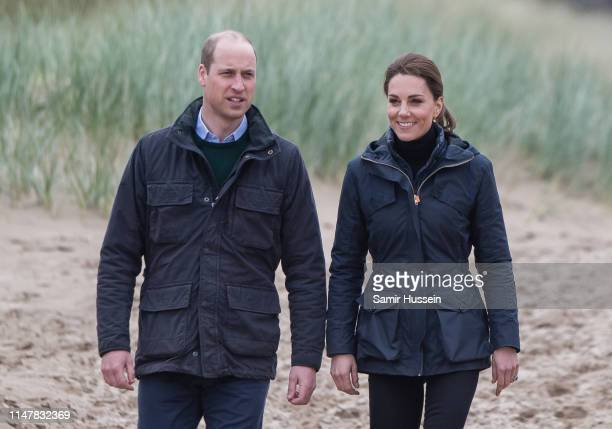 Prince William Duke of Cambridge and Catherine Duchess of Cambridge visit Newborough Beach to join the Menai Bridge Scouts as they explore the...