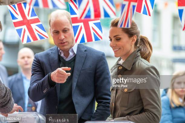 Prince William Duke of Cambridge and Catherine Duchess of Cambridge meet members of the public they visit Keswick Market place during a visit to...