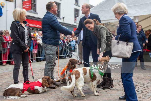 Prince William Duke of Cambridge and Catherine Duchess of Cambridge meet Kerry Irving and his three dogs Max Paddy and Harry as they visit Keswick...