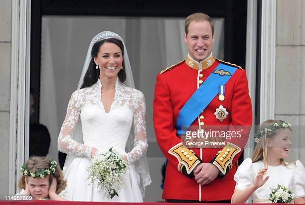 Prince William Duke of Cambridge and Catherine Duchess of Cambridge greet wellwishers from the balcony next to Grace Van Cutsem and Margarita...