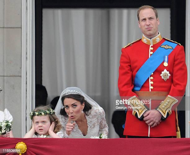Prince William Duke of Cambridge and Catherine Duchess of Cambridge next to Grace Van Cutsem greet wellwishers from the balcony at Buckingham Palace...