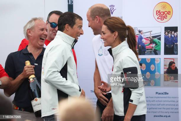 Prince William Duke of Cambridge and Catherine Duchess of Cambridge talk with Bear Grylls before he is awarded the King's Cup during the prize giving...