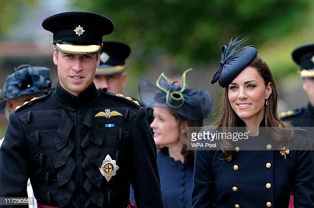 Prince William Duke of Cambridge and Catherine Duchess of Cambridge visit Victoria Barracks during a medal parade for the 1st Battalion Irish Guards...