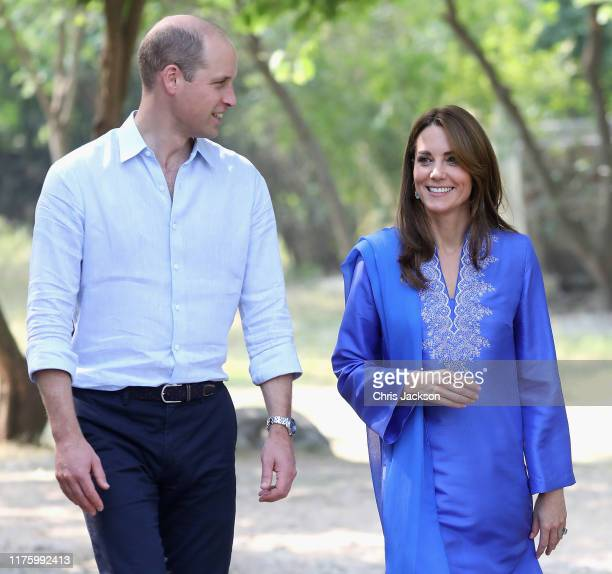 Prince William Duke of Cambridge and Catherine Duchess of Cambridge join a gathering of children from three different schools taking part in a number...