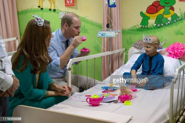 Prince William Duke of Cambridge and Catherine Duchess of Cambridge meet with cancer patient Wafia Remain 7 while on a visit to Shaukat Khanum...