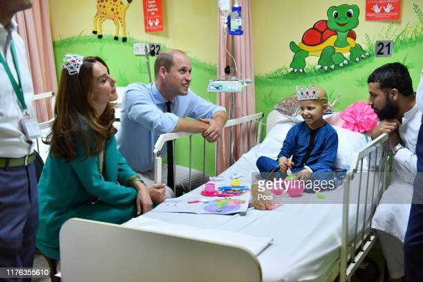 Prince William, Duke of Cambridge and Catherine, Duchess of Cambridge meet with cancer patient Wafia Remain 7, while on a visit to Shaukat Khanum...