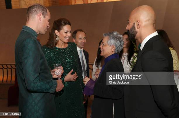 Prince William Duke of Cambridge and Catherine Duchess of Cambridge speak with guests as they attend a special reception hosted by the British High...