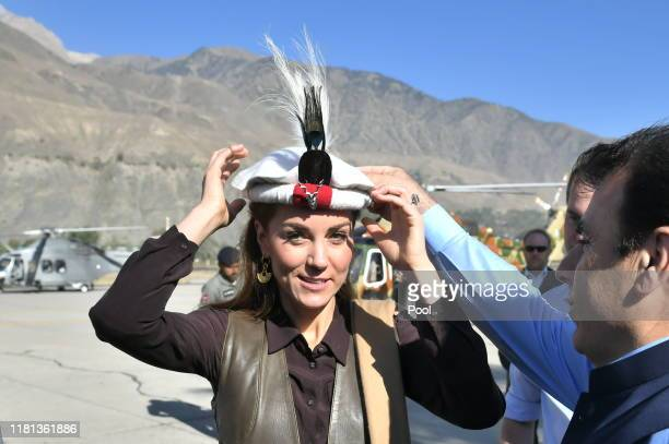 Prince William, Duke of Cambridge and Catherine, Duchess of Cambridge are welcomed as they arrive by helicopter on October 16, 2019 in Chitral,...