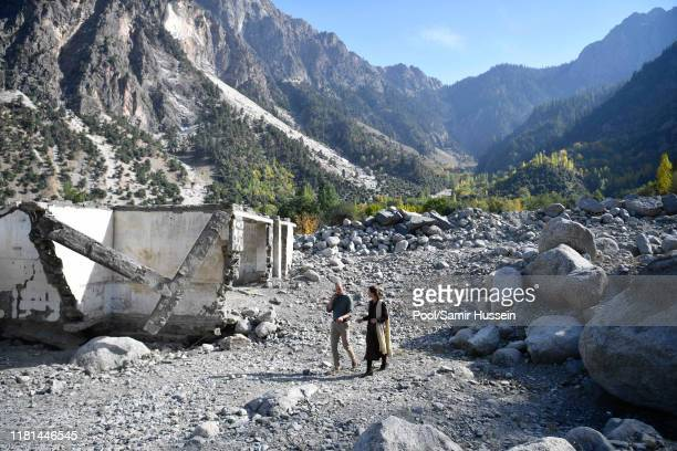 Prince William Duke of Cambridge and Catherine Duchess of Cambridge walk amongst flood damaged ruins in the village of Bumburet on October 16 2019 in...