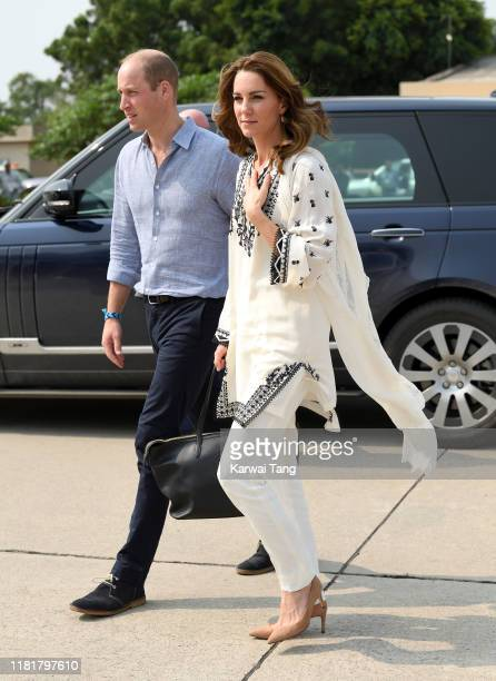 Prince William, Duke of Cambridge and Catherine, Duchess of Cambridge arrive at Lahore airport to take their flight back to Islamabad during their...