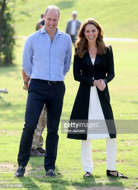 Prince William Duke of Cambridge and Catherine Duchess of Cambridge smile as they visit an Army Canine Centre where the UK provides support to a...