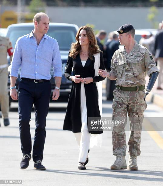 Prince William Duke of Cambridge and Catherine Duchess of Cambridge with British Army Lieutenant Colonel Colin Whitworth during a visit to an Army...