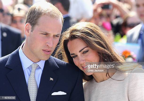 Prince William Duke of Cambridge and Catherine Duchess of Cambridge look on during an an official welcome ceremony at the Somba K'e Civic Plaza on...